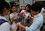 People bought flowers from street vendors in Beijing.