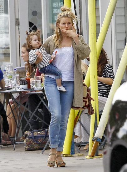 Sienna Miller carried baby Marlowe for an outing in London.