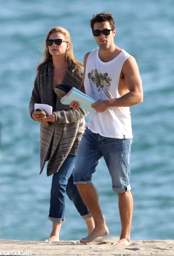 On and offscreen couple Emily VanCamp and Joshua Bowman shot Revenge on the beach in LA on Tuesday.