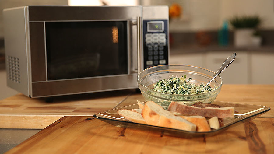 The Easiest Microwave Spinach Artichoke Dip We've Ever Made
