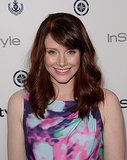 While attending an InStyle soiree, Bryce Dallas Howard styled her auburn hair in loose waves. For her makeup, she paired a flick of eyeliner with a bright pink lip.