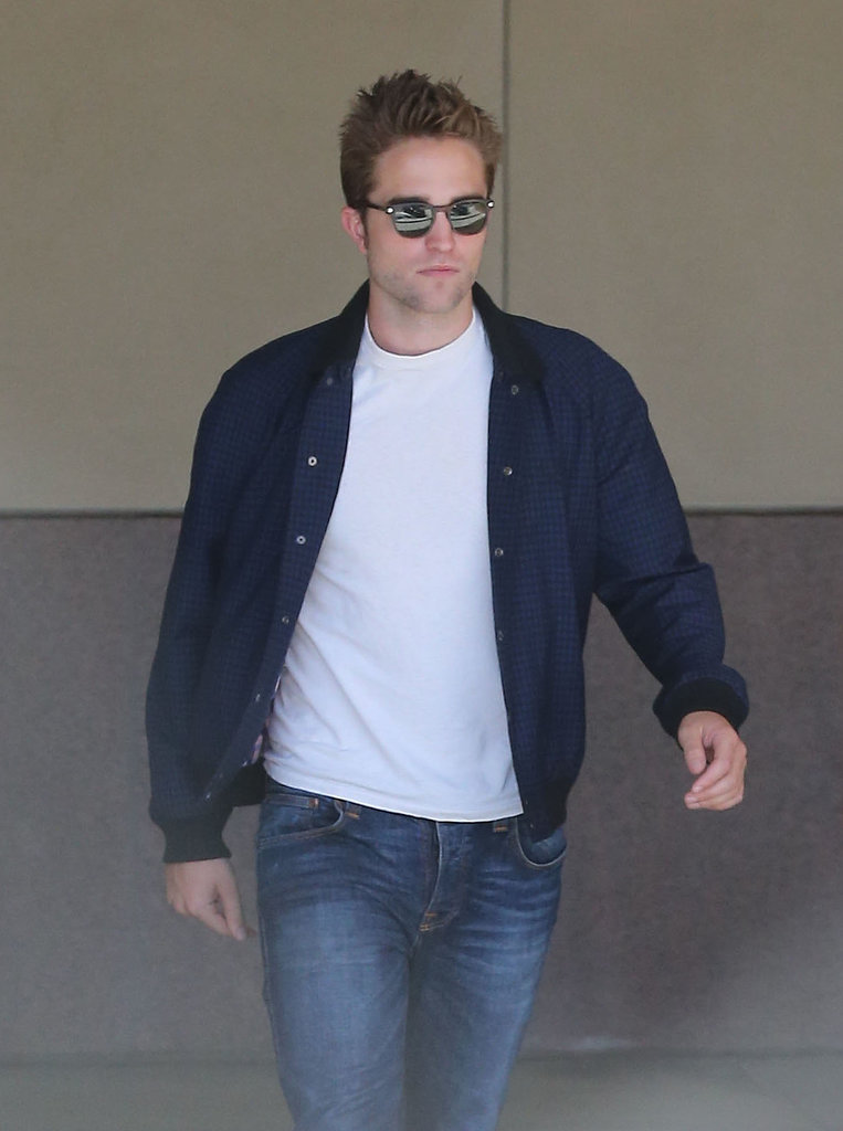 Robert Pattinson wore a white t-shirt.