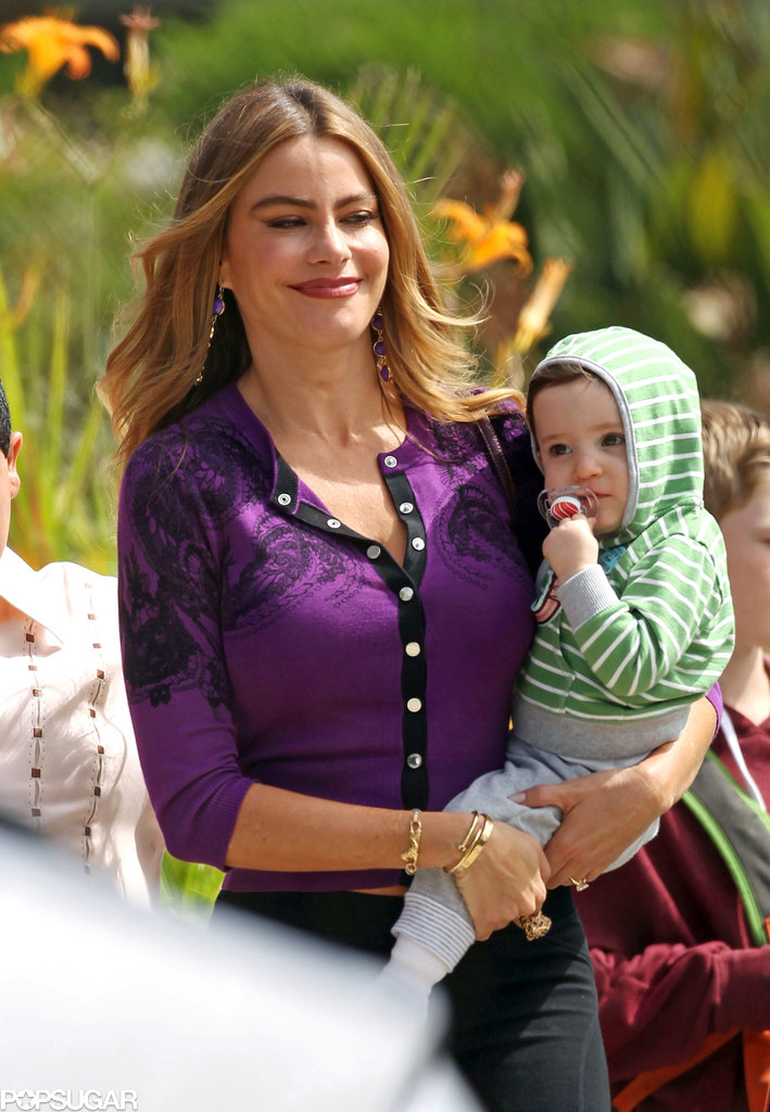 Sofia Vergara held her TV baby while filming Modern Family in LA on Thursday.