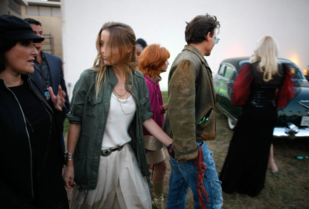 Johnny Depp and Amber Heard held hands and walked with Ricki Lake at the Johnny Ramone tribute at the Hollywood Forever Cemetery.