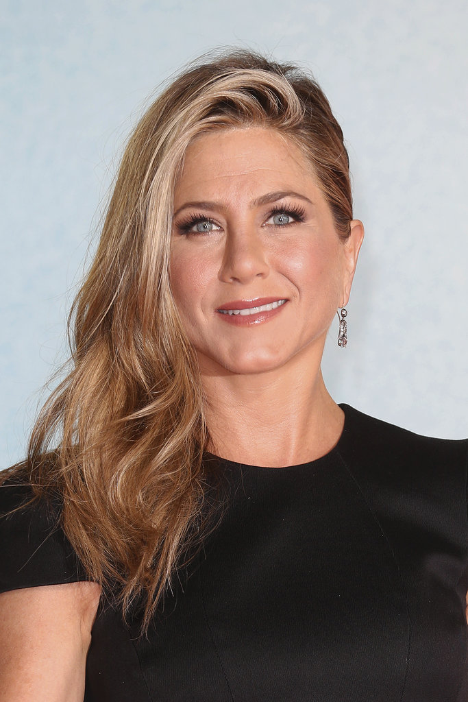 Jennifer Aniston doesn't usually stray far from her signature straight blow dry, but it was nice to see her play with her part, volume, and texture at the We're the Millers premiere in Germany.
