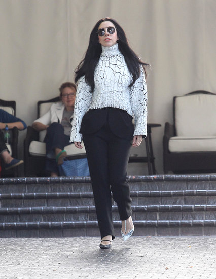 It wouldn't be hard to confuse this shot of Lady Gaga with a snap from the Fall 2013 Balenciaga collection — the artist chose a crackled sweatshirt top and peplum-trimmed pants from the line for an appearance in LA.