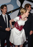 Emma Stone reached for Andrew Garfield's hand during their LA premiere of The Amazing Spider-Man in June 2012.