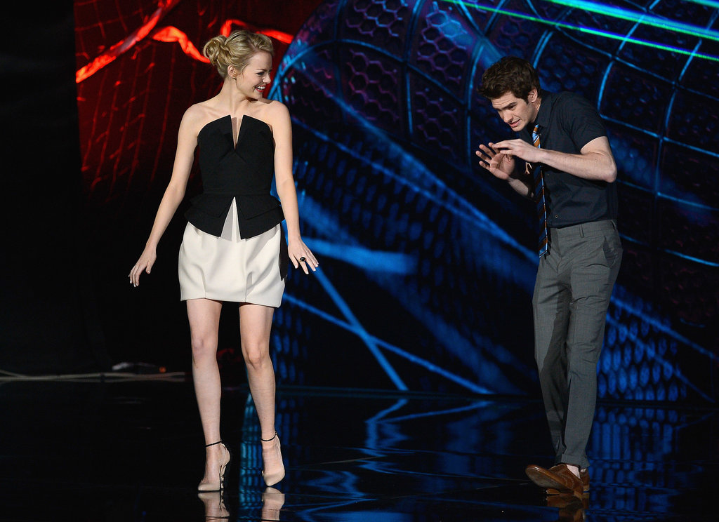 Andrew Garfield jokingly checked out his girlfriend, Emma Stone, on stage at the June 2012 MTV Movie Awards in LA.