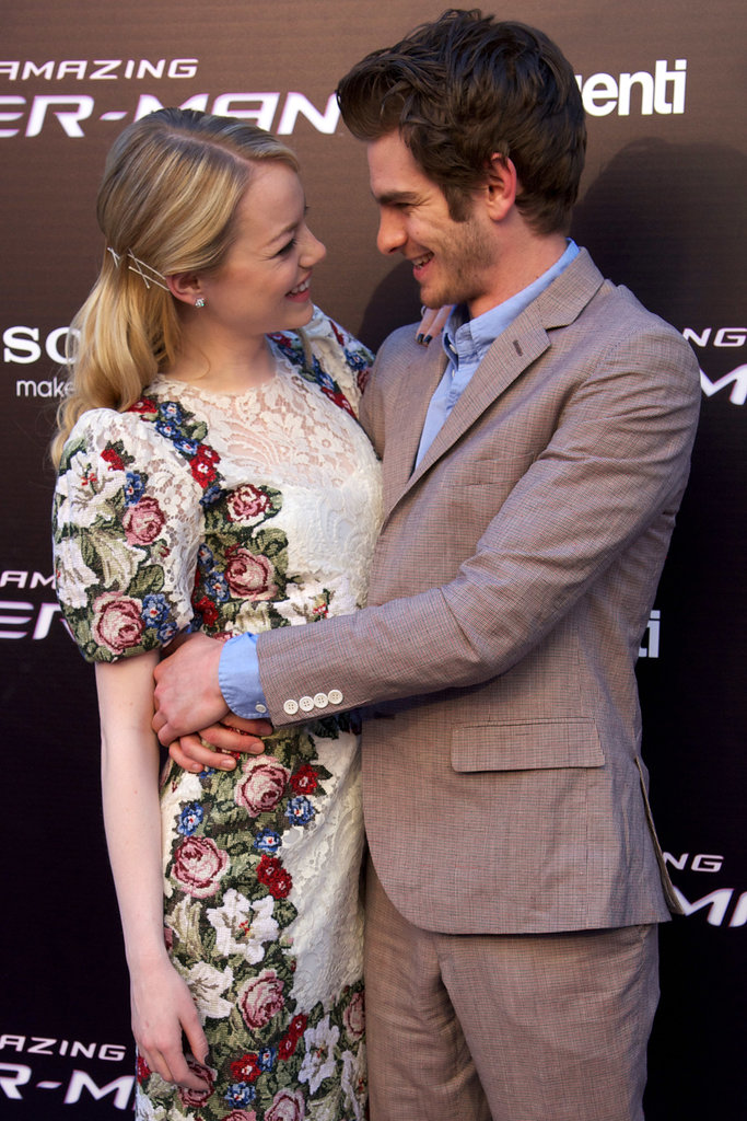 Andrew Garfield wrapped his arms around Emma Stone at The Amazing Spider-Man premiere in Madrid in June 2012.
