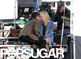 Andrew Garfield and Emma Stone kissed for the cameras while filming for The Amazing Spider-Man in LA in January 2011.