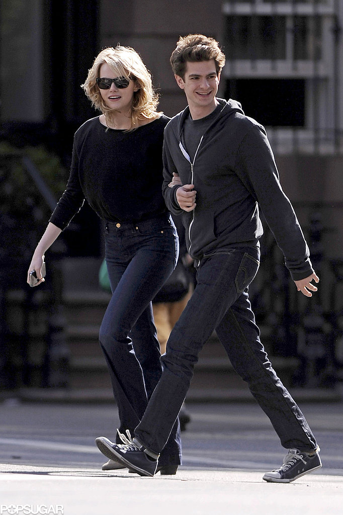 Emma Stone held onto Andrew Garfield as the couple stepped out in nearly matching outfits for an April 2012 outing in NYC.