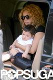 Shakira cradled her baby boy, Milan, in Paris.