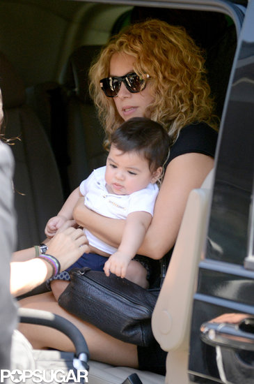 Shakira cradled her baby boy, Milan, in Paris on Friday.