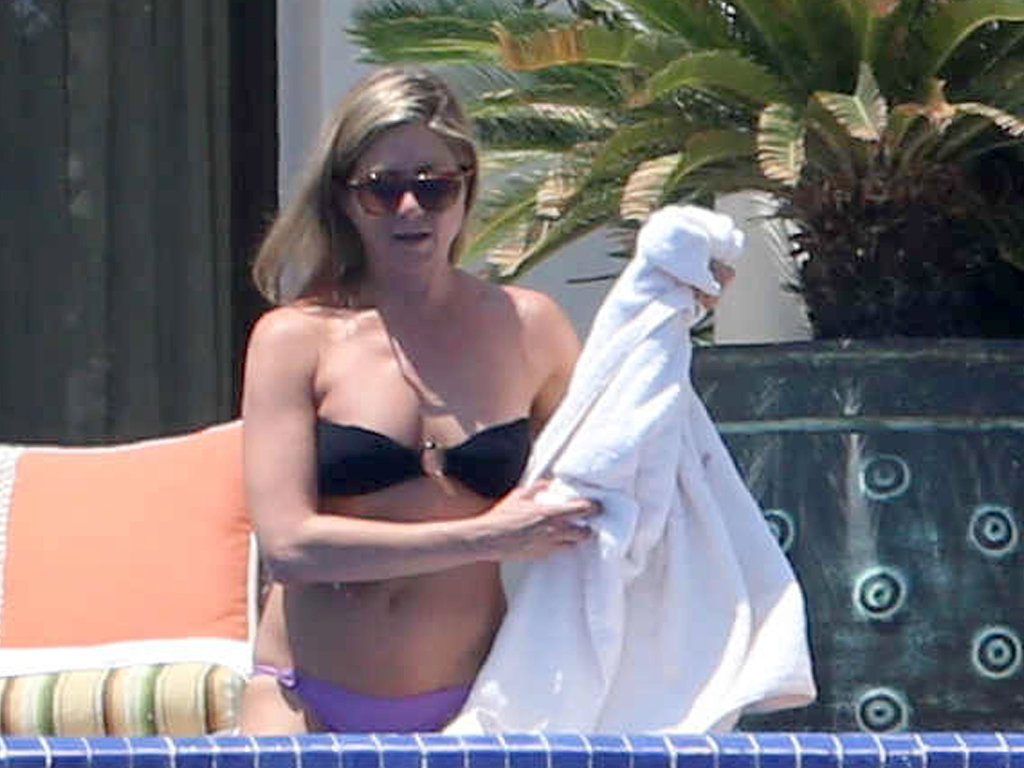 Jennifer Aniston wore a black bandeau bikini top in Mexico in August.