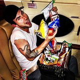 """Adam Levine shared a snap while enjoying """"snacks on snacks on snacks"""" during a plane ride. Source: Instagram user adamlevine"""