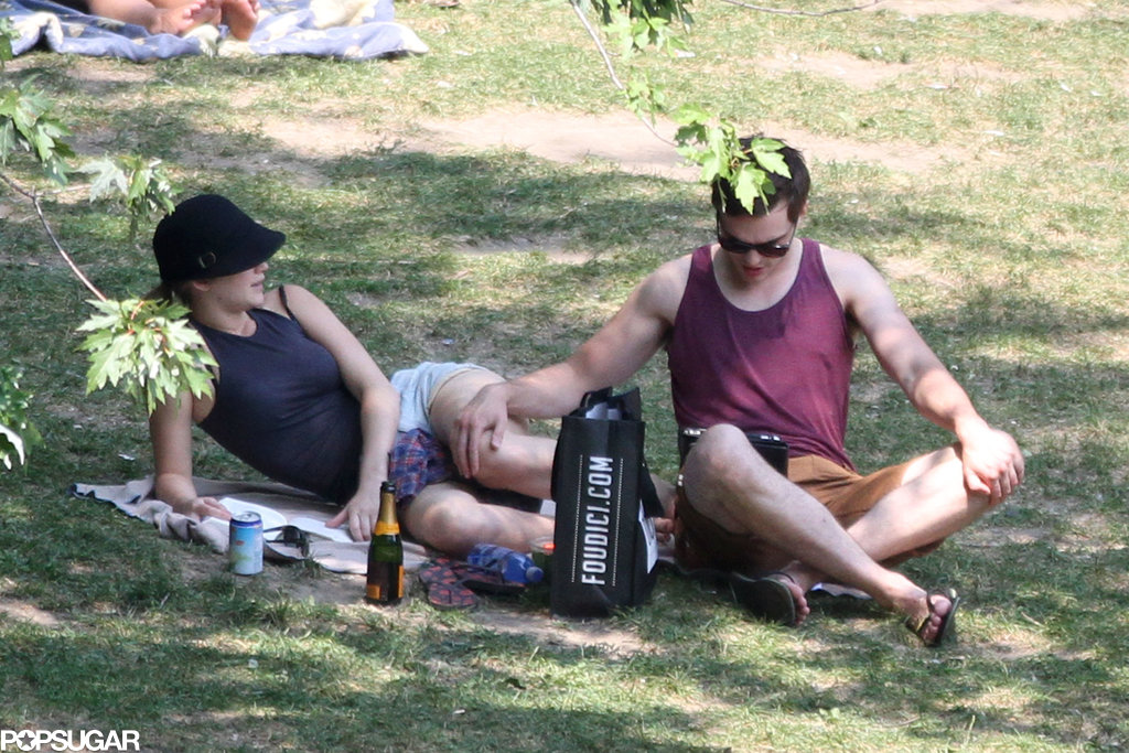 Jennifer Lawrence and Nicholas Hoult found a shady spot to hang out.
