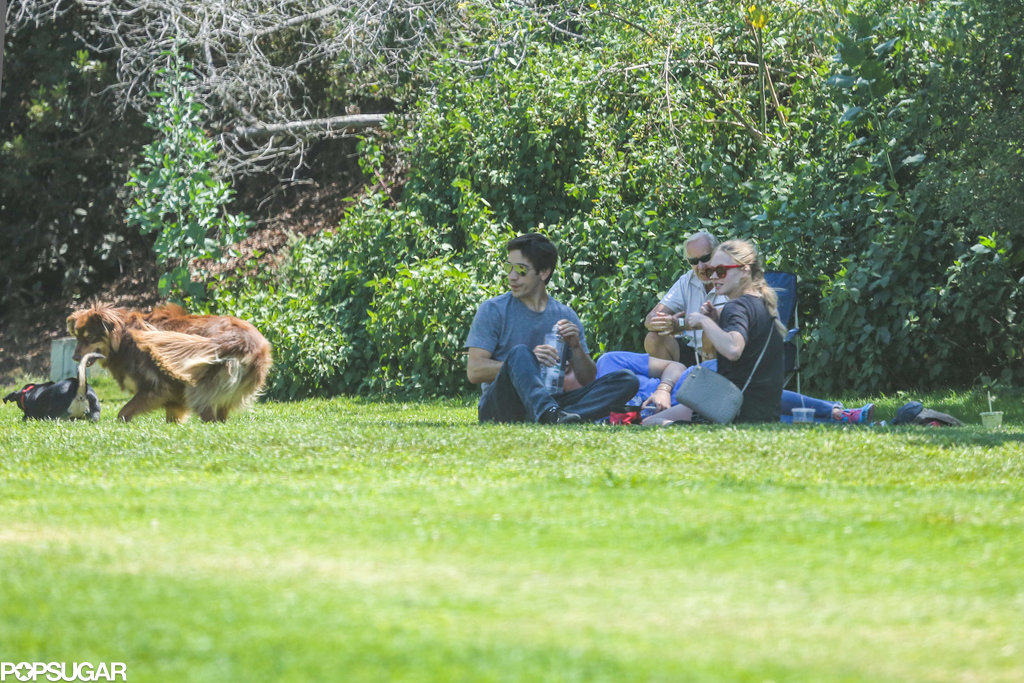 Amanda Seyfried and Justin Long watched as Amanda's dog Finn played around.