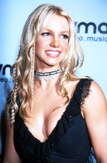No VMAs roundup would be complete without Britney Spears; in 2000 she wore a crimped and curled hairstyle.