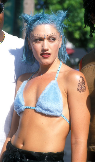 At the 1998 VMAs, Gwen Stefani donned cotton candy-colored hair and gemstones dotted along her eyes. It was a look very different from her current signature blond locks and red lipstick.