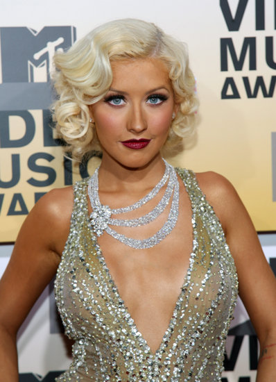 Christina Aguilera opted for a flapper vibe at the 2006 VMAs. Her hair was styled in Marcel waves and her lipstick was a deep plum shade.
