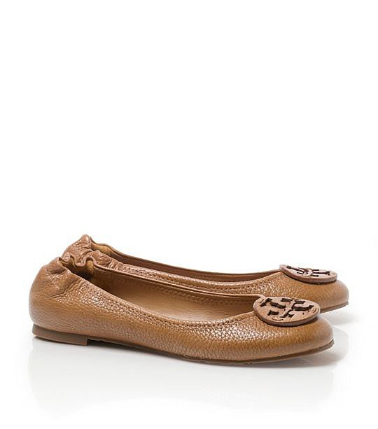 Pair Tory Burch's pebbled leather flats ($225) with jeans and a crisp white button-up top for a preppy off-duty vibe.