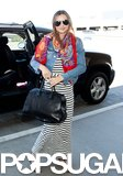 Miranda Kerr wore a striped maxi dress at LAX.