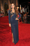 Selena Gomez struck a pose in a long-sleeved navy Atelier Versace gown with a bustier-style bodice and a thigh-high side slit. She accessorized with Lorraine Schwartz carved green jade earrings.