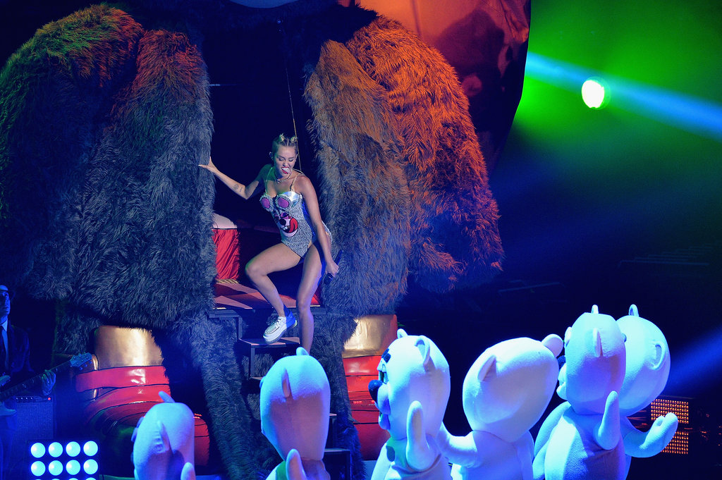 Miley Cyrus entered through a giant fuzzy bear at the VMAs.