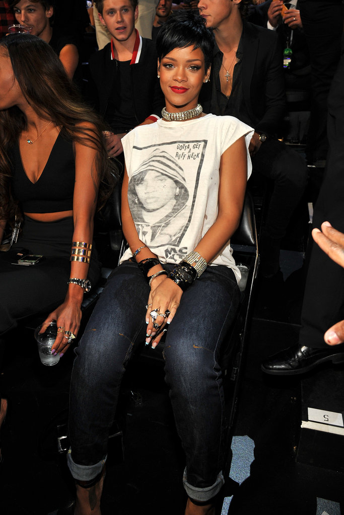 Rihanna went casual in a white muscle tee and cuffed denim, which she amped up with tons of shiny baubles.