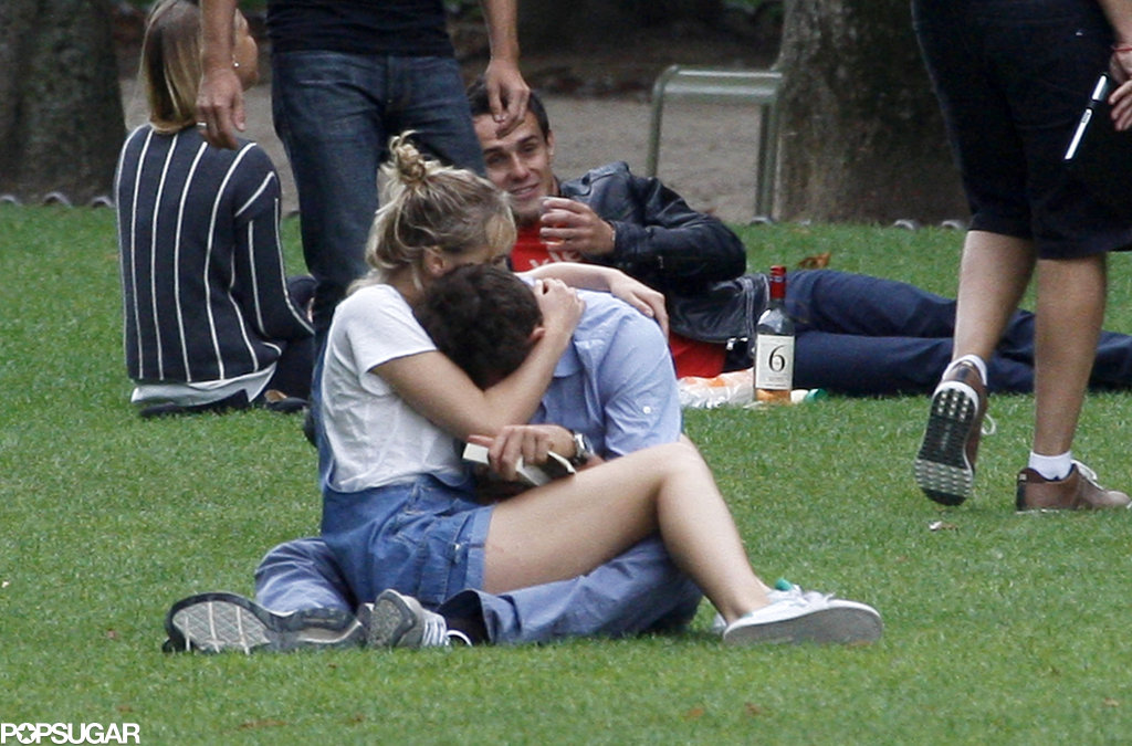 Suki Waterhouse and Bradley Cooper stayed close while at a park in Paris.