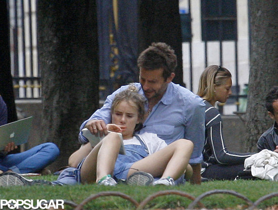 Bradley Cooper and Suki Waterhouse read together at a Paris park.