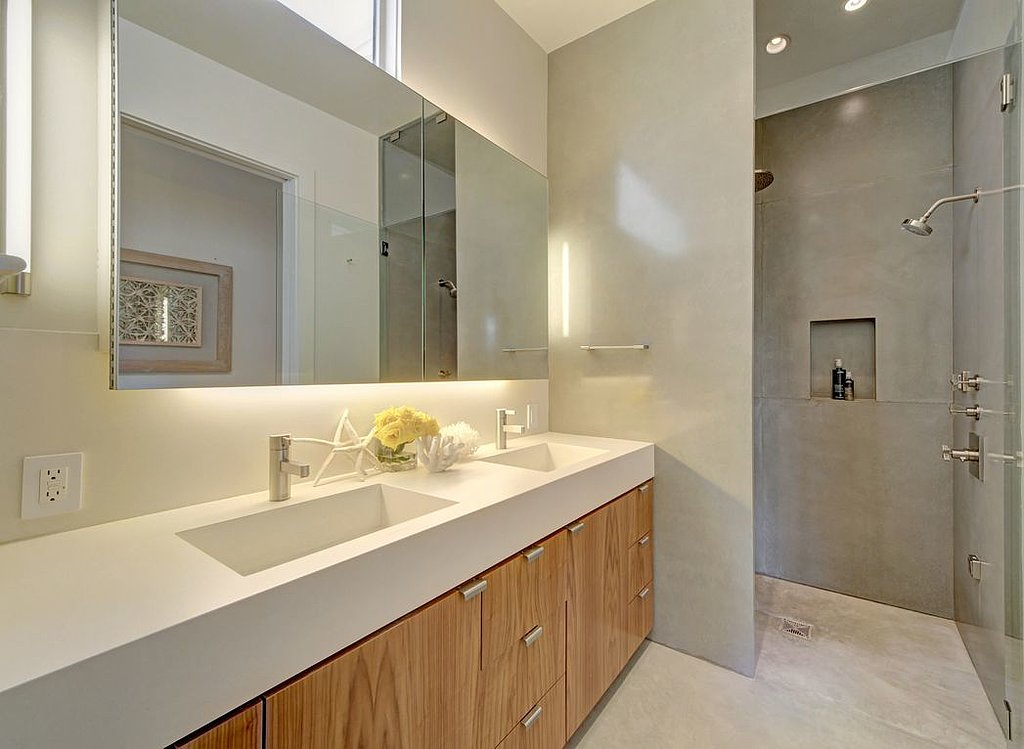 Clean lines and muted tones provide a tranquil, spa-like feel for the bathroom.