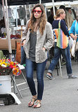 Make your sandals Fall-ready with dark denim skinnies and an anorak à la Jessica Biel.