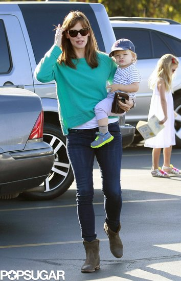 Jennifer Garner carried little Samuel on a trip to a farmers market in LA on Sunday.