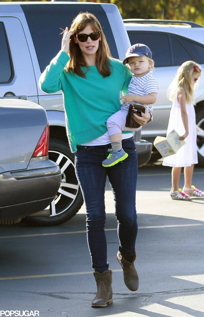 Jennifer Garner carried little Samuel on a trip to a farmers market in LA.