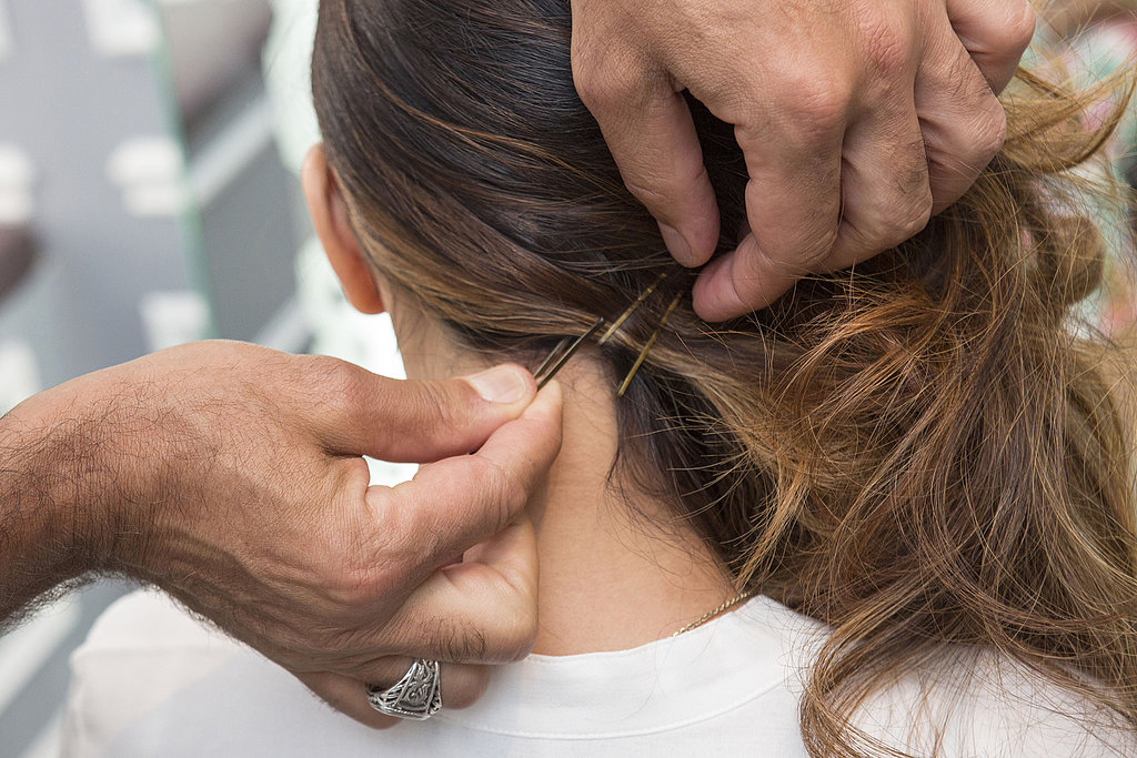 Pull the waves to one side, securing the hair with bobby pins at the neck to keep it in place.