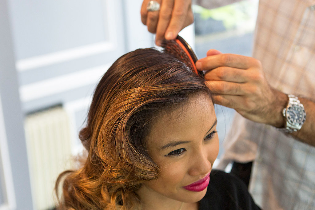 Brush and smooth the hair around the part for a sleek look.