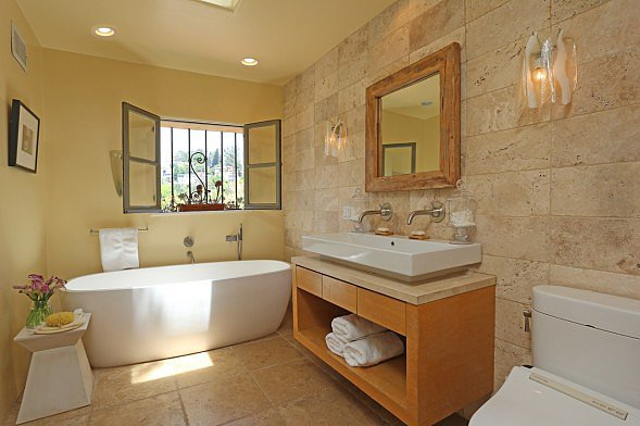 A modern tub and sink feel zen when paired with pale tiles and soothing paint colors.