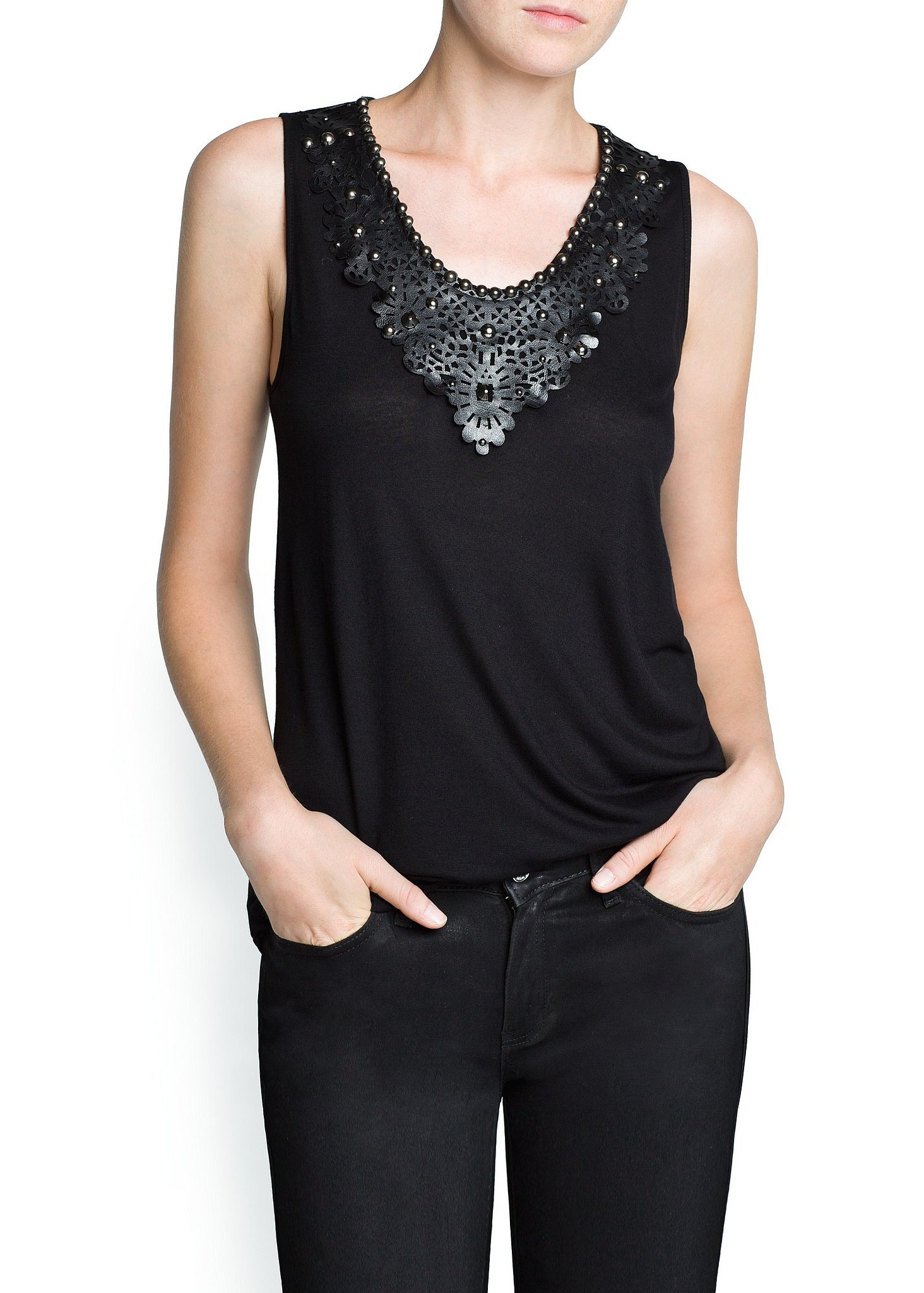 A touch of leather can add a luxe feel to basics. This Mango tank ($35) is far from simple thanks to the laser-cut acc