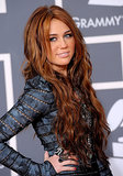 At the 2010 Grammy Awards, Miley went for a totally different look that featured wavy chestnut hair that was more rock star than country.