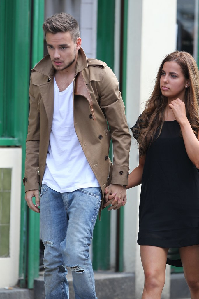Birthday boy Liam Payne held his girlfriend's hand between takes.