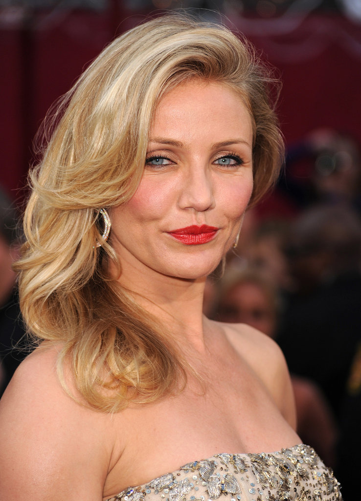 Side-swept curls, red lips, and fully rimmed eyes made for a look that was 100 percent Hollywood glamour.