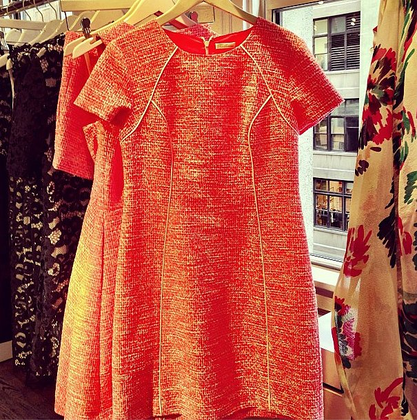 How can you not smile at a bright orange dress by Shoshanna?