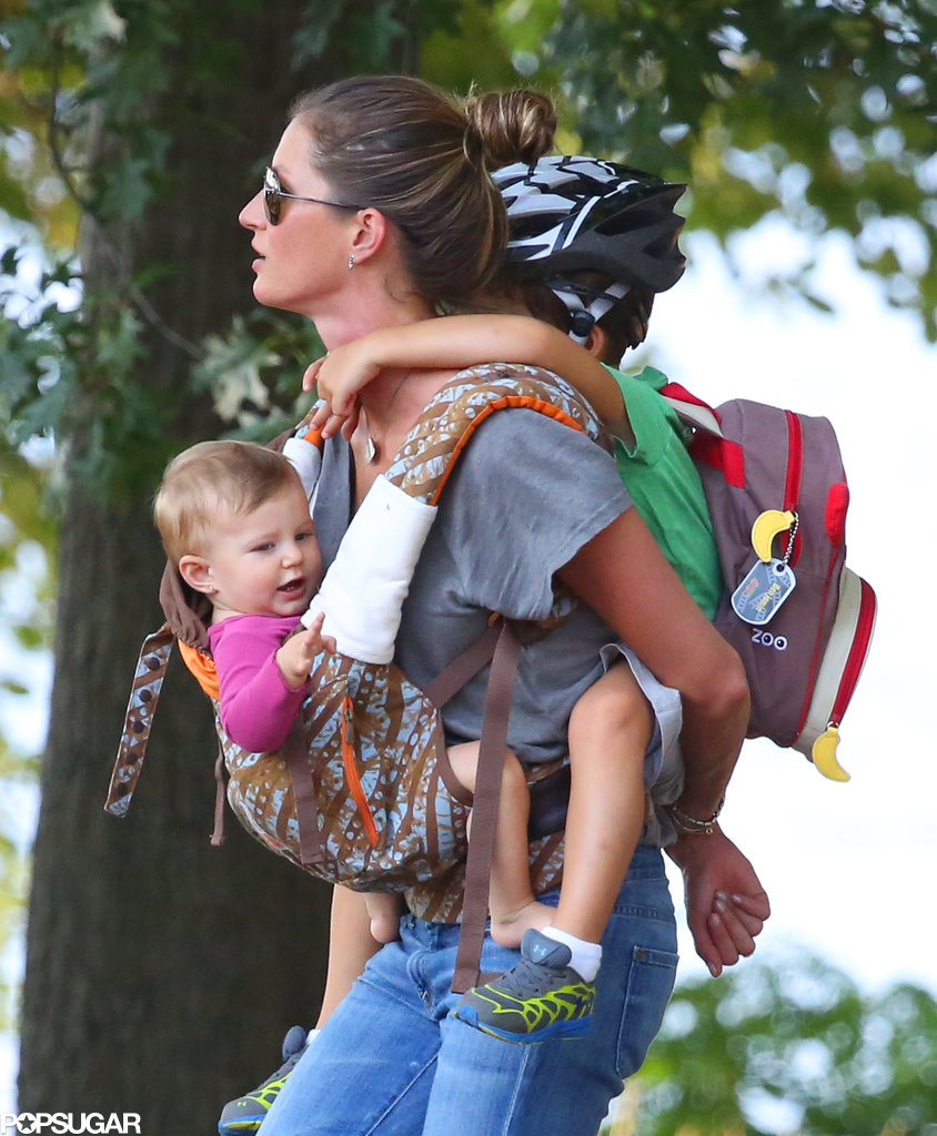 Gisele Bündchen carried her kids Benjamin and Vivian through a Boston park.