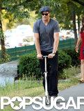 Tom Brady followed his son's lead, riding a scooter through a Boston park.