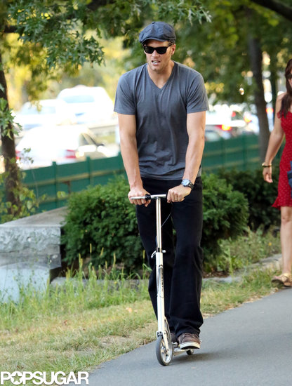 Tom Brady followed his son's lead, riding a scooter through a Boston park.