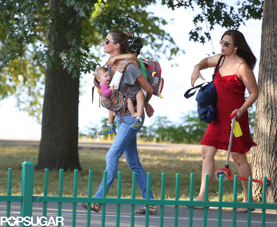 Gisele Bündchen carried two of her kids, Vivian and Benjamin, through a Boston park on Friday.