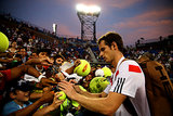 Andy Murray took some time to sign autographs for fans after winning his men's singles second-round match.