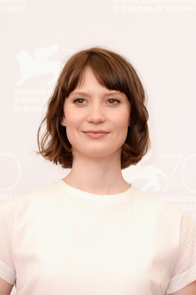 Mia Wasikowska wore her bob in subtle waves at the Tracks photocall, splitting her fringe on the side for a soft effect.