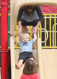 Jennifer Garner held son Samuel's hands as he went down the slide.
